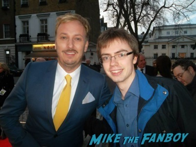 director james bobin signing autographs Muppets Most Wanted UK Premiere red carpet ricky gervais2