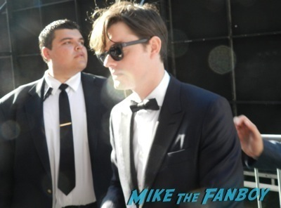 sam riley signing autographs Maleficent los angeles premiere photos brad pitt signing autographs  angelina jolie   19