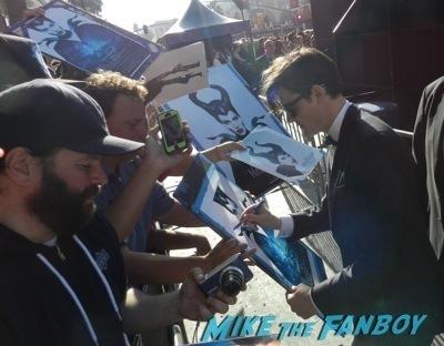 sam riley signing autographs Maleficent los angeles premiere photos brad pitt signing autographs  angelina jolie   19