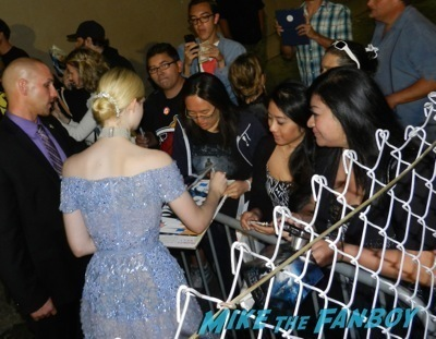 elle fanning signing autographs  Maleficent los angeles premiere photos brad pitt signing autographs  angelina jolie   46