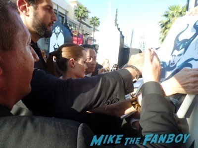 angelina jolie signing autographs Maleficent los angeles premiere photos brad pitt signing autographs  angelina jolie   34