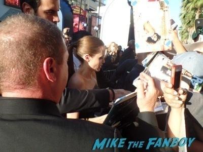 angelina jolie signing autographs Maleficent los angeles premiere photos brad pitt signing autographs  angelina jolie   34