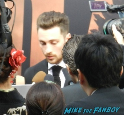 aaron-taylor Johnson signed autograph men's health magazine signing autographs Godzilla movie premiere aaron-taylor Johnson elizabeth olsen30