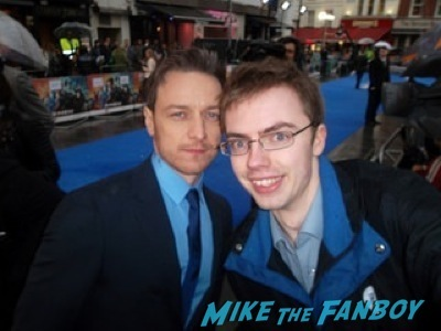 James McAvoy signing autographs X-Men: Days of Future Past UK premiere blue carpet michael Fassbender 10
