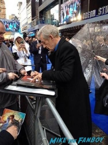 Ian McKellen  signing autographs X-Men: Days of Future Past UK premiere blue carpet michael Fassbender   13