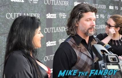 Ron D. Moore and Diana Gabaldon talking to members of the press