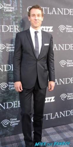 Tobias Menzies (Frank Randall/Black Jack Randall) looking dashing in his suit on the Tartan Carpet