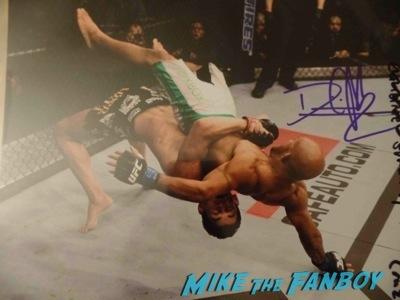 Dominick Cruz UFC-Fan-Expo-Day-1-autograph-signing-photos-rare