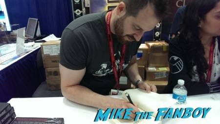 "Joe Abercrombie signs his book ""Half a King"" at the Del Rey booth"