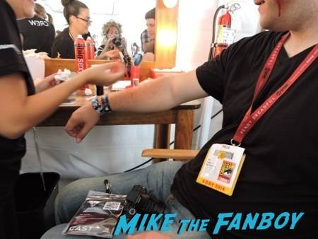 Mike getting his tattoos.  Who's that in the mirror?