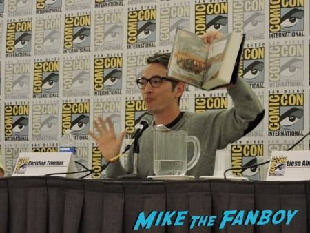 Christian Trimmer showing off a book at the Simon & Schuster panel