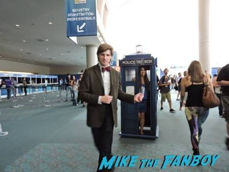 The Doctor showing off his swagger while the Tardis follows