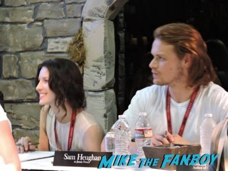 "Caitriona Balfe (Claire Randall) and Sam Heughan (Jaime Fraser) at the ""Outlander"" signing"