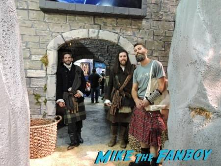 "Kilted men are all smiles at the ""Outlander"" booth"