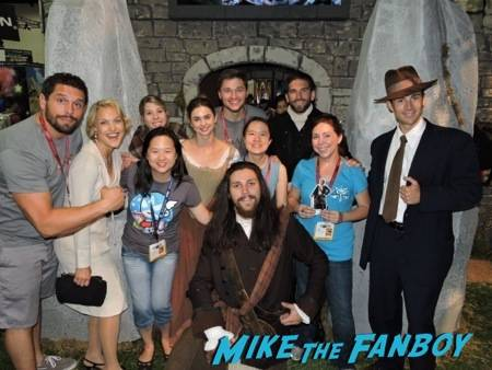 """Erica, Linda, myself and #PocketJaime with the wonderful actors and crew at the """"Outlander"""" booth"""