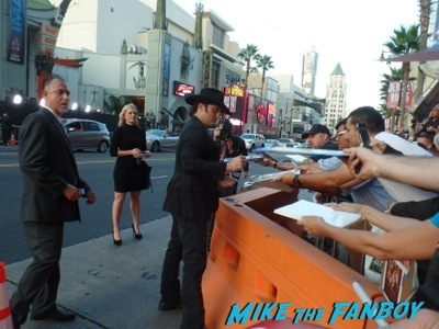 Robert rodriguez signing autographs Sin City 2 a dame to kill for premiere los angeles