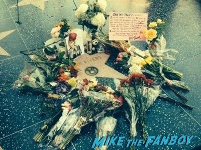 Joan Rivers walk of fame star fans remember flowers  1