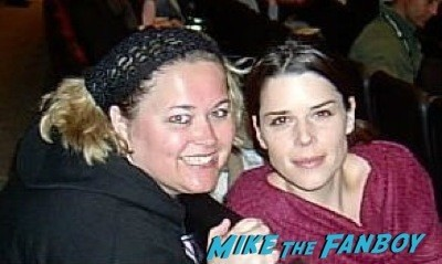 Neve Campbell signing autographs fan photo
