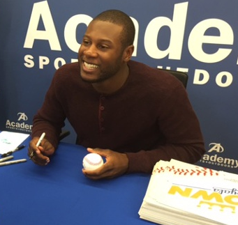 baseball player signing autographs