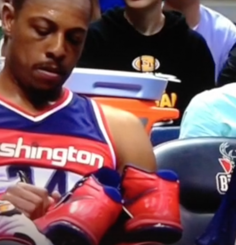 Paul Pierce signed an autograph for a fan in the middle of a game