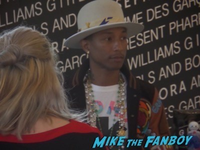 Pharrell Williams signing autographs meet and greet