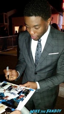 chadwick boseman signing autographs