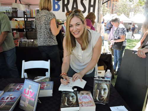 "Risa Green signing her book ""Projection"""