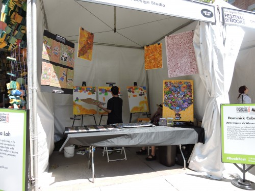 Artist painting at the Festival