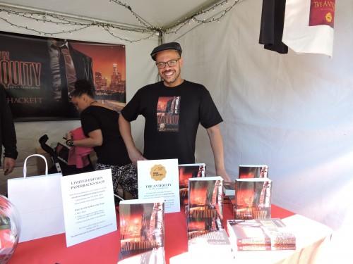 "Darren Hackett with his book ""The Antiquity"""