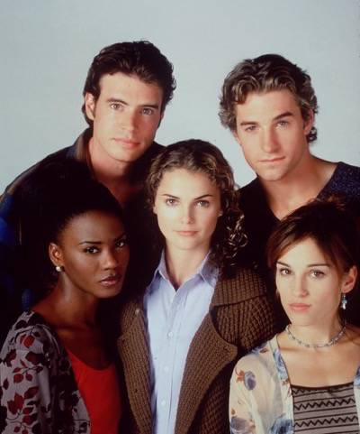 "382609 01: The cast of ""Felicity."" Clockwise from top left: Scott Foley, Scott Speedman, Amy Jo Johnson, Keri Russel (center) and Tangi Miller."