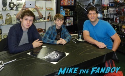 Ty Simpkins And Nick Robinson jurassic world poster signing autograph 6