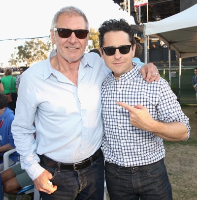 SAN DIEGO, CA - JULY 10:  Actor Harrison Ford (L), director J.J. Abrams and more than 6000 fans enjoyed a surprise `Star Wars` Fan Concert performed by the San Diego Symphony, featuring the classic `Star Wars` music of composer John Williams, at the Embarcadero Marina Park South on July 10, 2015 in San Diego, California.  (Photo by Jesse Grant/Getty Images for Disney) *** Local Caption *** Harrison Ford; J.J. Abrams