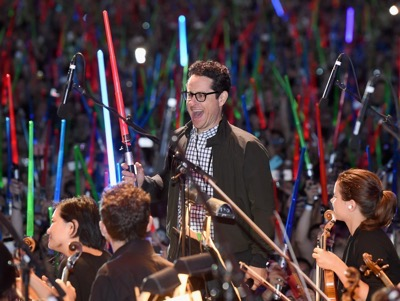 "SAN DIEGO, CA - JULY 10: Director J.J. Abrams and more than 6000 fans enjoyed a surprise ""Star Wars"" Fan Concert performed by the San Diego Symphony, featuring the classic ""Star Wars"" music of composer John Williams, at the Embarcadero Marina Park South on July 10, 2015 in San Diego, California.  (Photo by Michael Buckner/Getty Images for Disney) *** Local Caption *** J.J. Abrams"