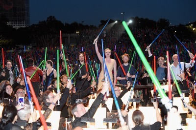 "SAN DIEGO, CA - JULY 10:  (L-R) Producer Kathleen Kennedy, director J.J. Abrams, actors John Boyega, Daisy Ridley, Oscar Isaac, Gwendoline Christie, Domhnall Gleeson, Carrie Fisher, Mark Hamill, Harrison Ford and more than 6000 fans enjoyed a surprise ""Star Wars"" Fan Concert performed by the San Diego Symphony, featuring the classic ""Star Wars"" music of composer John Williams, at the Embarcadero Marina Park South on July 10, 2015 in San Diego, California.  (Photo by Michael Buckner/Getty Images for Disney) *** Local Caption *** Harrison Ford; Mark Hamill; Carrie Fisher; Domhnall Gleeson; Gwendoline Christie; Adam Driver; Oscar Isaac; Daisy Ridley; John Boyega; J.J. Abrams; Kathleen Kennedy"