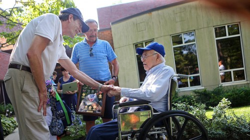(072915 Lynn, MA) Ray Lustig, L,  greets Roland Dube,91, R, as Dube's son, John, holds a shadowbox of his medals.  (Wednesday,July 29, 2015). Staff Photo by Nancy Lane