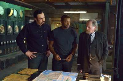"THE STRAIN -- ""Identity"" -- Episode 206 (Airs August 16, 10:00 pm e/p) Pictured: (l-r) Kevin Durand as Vasiliy Fet, Roger Cross as Reggie Fitzwilliam, David Bradley as Abraham Setrakian. CR: Michael Gibson/FX"
