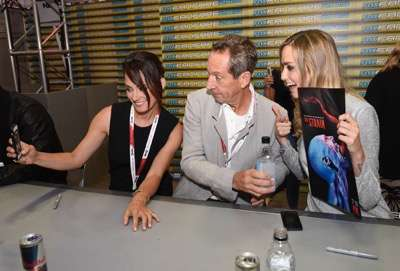 From left, Natalie Brown, Jonathan Hyde, and Ruta Gedmintas at the 'The Strain' booth signing during Comic-Con International 2015 at the San Diego Convention Center on July 12, 2015 in San Diego, California. Cr: Alan Hess/PictureGroup/FX