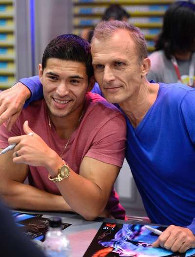 Miguel Gomez,  left, and Richard Sammel  at the 'The Strain' booth signing during Comic-Con International 2015 at the San Diego Convention Center on July 12, 2015 in San Diego, California. Cr: Alan Hess/PictureGroup/FX