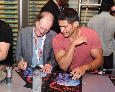 David Bradley, left, and Miguel Gomez at the 'The Strain' booth signing during Comic-Con International 2015 at the San Diego Convention Center on July 12, 2015 in San Diego, California. Cr: Alan Hess/PictureGroup/FX