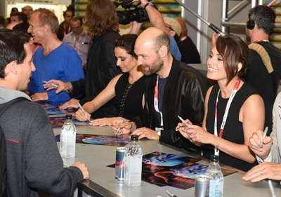 From left, Mia Maestro, Corey Stoll, and Natalie Brown at the 'The Strain' booth signing during Comic-Con International 2015 at the San Diego Convention Center on July 12, 2015 in San Diego, California. Cr: Alan Hess/PictureGroup/FX