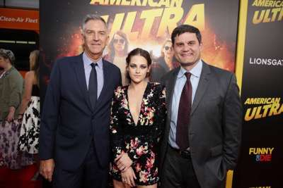Steve Beeks, Co-Chief Operating Officer and President of Lionsgate Motion Picture Group, Kristen Stewart and Jason Constantine, President of Acquisitions and Co-Productions of Lionsgate Motion Picture Group, seen at The World Premiere of Lionsgate's 'American Ultra' at Ace Hotel on Tuesday, August 18, 2015, in Los Angeles, CA. (Photo by Eric Charbonneau/Invision for Lionsgate/AP Images)