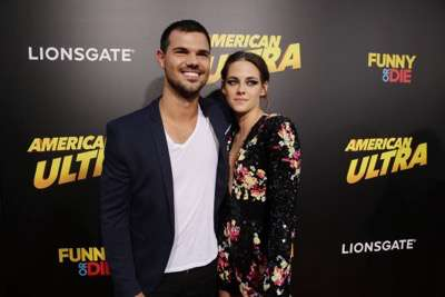 Taylor Lautner and Kristen Stewart seen at The World Premiere of Lionsgate's 'American Ultra' at Ace Hotel on Tuesday, August 18, 2015, in Los Angeles, CA. (Photo by Eric Charbonneau/Invision for Lionsgate/AP Images)