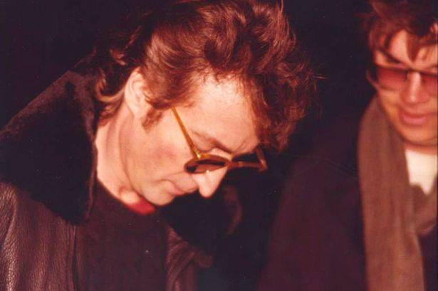 john lennon signing an autograph