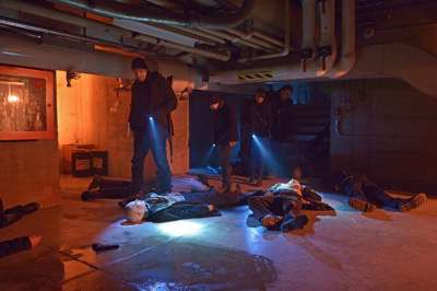 """THE STRAIN -- """"The Battle For Red Hook"""" -- Episode 209 (Airs September 6, 10:00 pm e/p) Pictured: (l-r) Corey Stoll as Ephraim Goodweather, Max Charles as Zack Goodweather, Mia Maestro as Nora Martinez, Kevin Durand as Vasiliy Fet. CR: Michael Gibson/FX"""