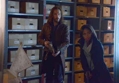 "SLEEPY HOLLOW: Ichabod (Tom Mison, L) and Abbie (Nicole Beharie, R) look for a dangerous book of spells in the ""Spellcaster"" episode of SLEEPY HOLLOW aiirng Monday, Feb. 2 (9:00-10:00 PM ET/PT) on FOX. ©2014 Fox Broadcasting Co. CR: Brownie Harris/FOX"