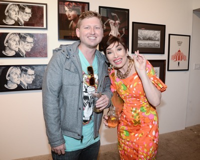 Actress Naomi Grossman, right, and artist J.Q. Hammer seen at the opening night of an American Horror Story-inspired fan art exhibition at the Hero Complex Gallery in Los Angeles on Friday, Oct. 2, 2015. The pop art exhibition, which runs through Oct. 18, features more than 100 originals, prints and sculptures. American Horror Story: Freak Show will be released on Blu-ray and DVD on Oct. 6.  (Photo by Dan Steinberg/Invision for Twentieth Century Fox Home EntertainmentAP Images)