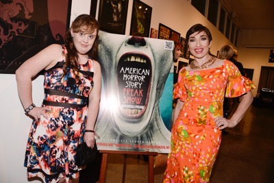 Actress Naomi Grossman, right, and actress Jamie Brewer seen at the opening night of an American Horror Story-inspired fan art exhibition at the Hero Complex Gallery in Los Angeles on Friday, Oct. 2, 2015. The pop art exhibition, which runs through Oct. 18, features more than 100 originals, prints and sculptures. American Horror Story: Freak Show will be released on Blu-ray and DVD on Oct. 6.  (Photo by Dan Steinberg/Invision for Twentieth Century Fox Home EntertainmentAP Images)