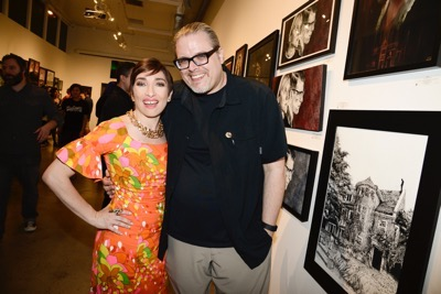 Actress Naomi Grossman, left, and gallery owner Adam Smasher seen at the opening night of an American Horror Story-inspired fan art exhibition at the Hero Complex Gallery in Los Angeles on Friday, Oct. 2, 2015. The pop art exhibition, which runs through Oct. 18, features more than 100 originals, prints and sculptures. American Horror Story: Freak Show will be released on Blu-ray and DVD on Oct. 6.  (Photo by Dan Steinberg/Invision for Twentieth Century Fox Home EntertainmentAP Images)