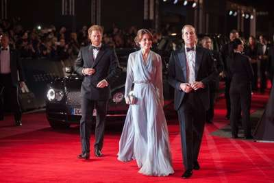 October 26, 2015 - London, England: (L to R) Prince Harry, Catherine, Duchess of Cambridge and Prince William, Duke of Cambridge attend the Royal World Premiere of SPECTRE at Royal Albert Hall.