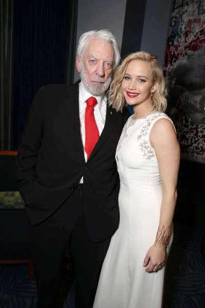Exclusive - Donald Sutherland and Jennifer Lawrence seen at Los Angeles Premiere of Lionsgate's 'The Hunger Games: Mockingjay - Part 2' on Monday, November 16, 2015, in Los Angeles, CA. (Photo by Eric Charbonneau/Invision for Lionsgate/AP Images)